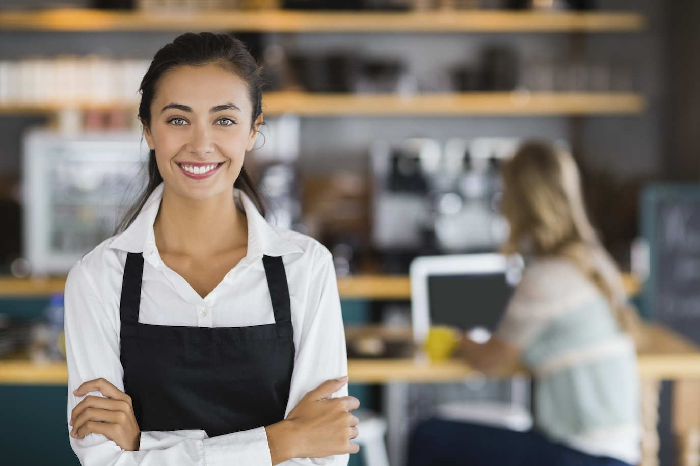 Woman in apron smiling